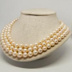 Collar de perlas con broche...